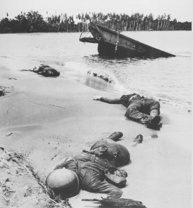 January 1943: The bodies of three American soldiers, fallen in the battle for Buna and Gona, lie on the beach of the island in the Papua New Guinea region during World War II. (AP Photo)
